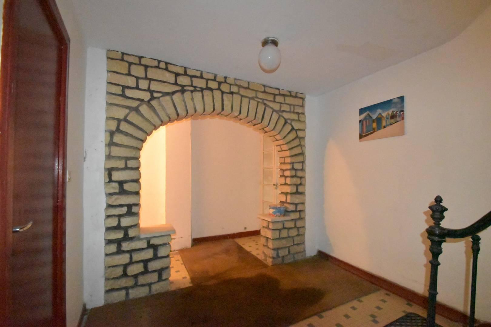 Entrée Mur en briques Moquette