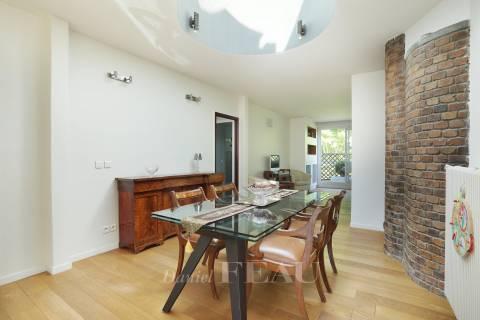Dining room Wooden floor Exposed bricks