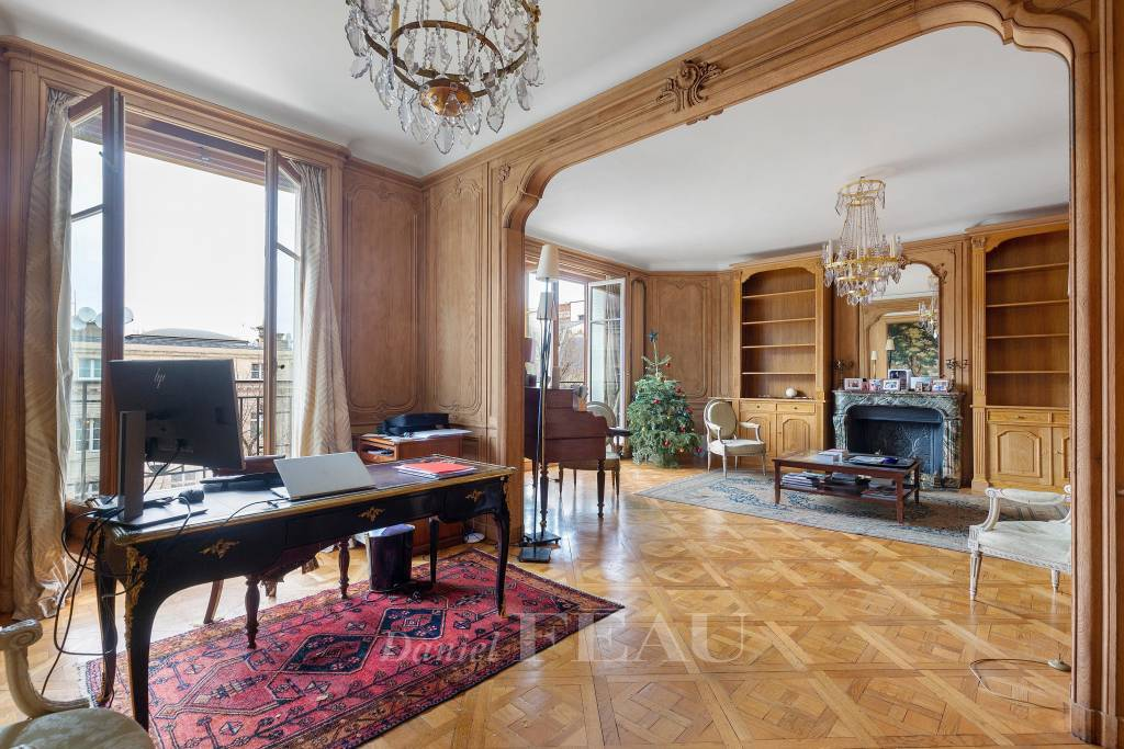 Large double reception room with parquet flooring, woodwork, fireplace, balcony and open view