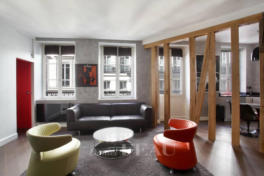 Living room, wooden floor, exposed wooden beams