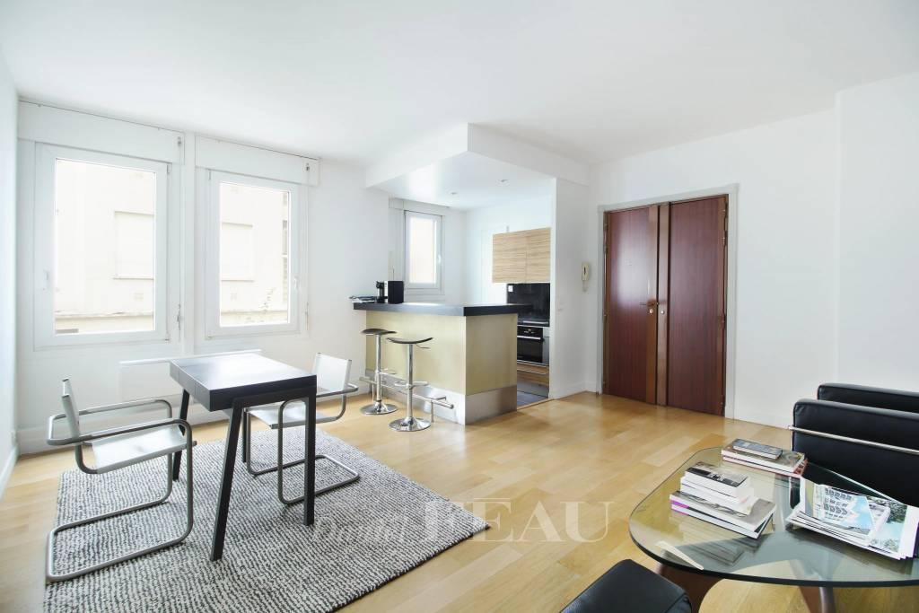Living room, open kitchen, wooden floor