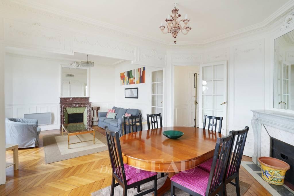 Dining room Wooden floor Chandelier Fireplace