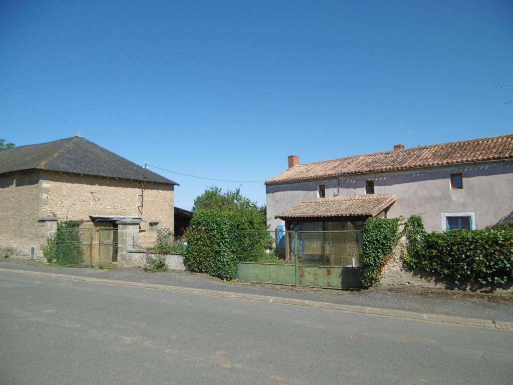 Character house on the edge of a village