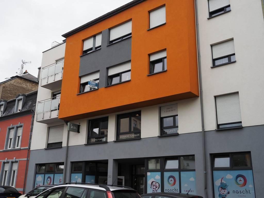 +++SOUS-COMPROMIS+++Appartement centre-ville avec parking intérieur