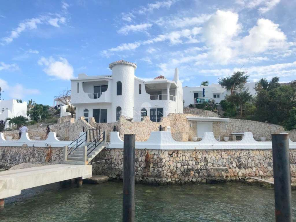 Rare lagoon front villa with boat dock
