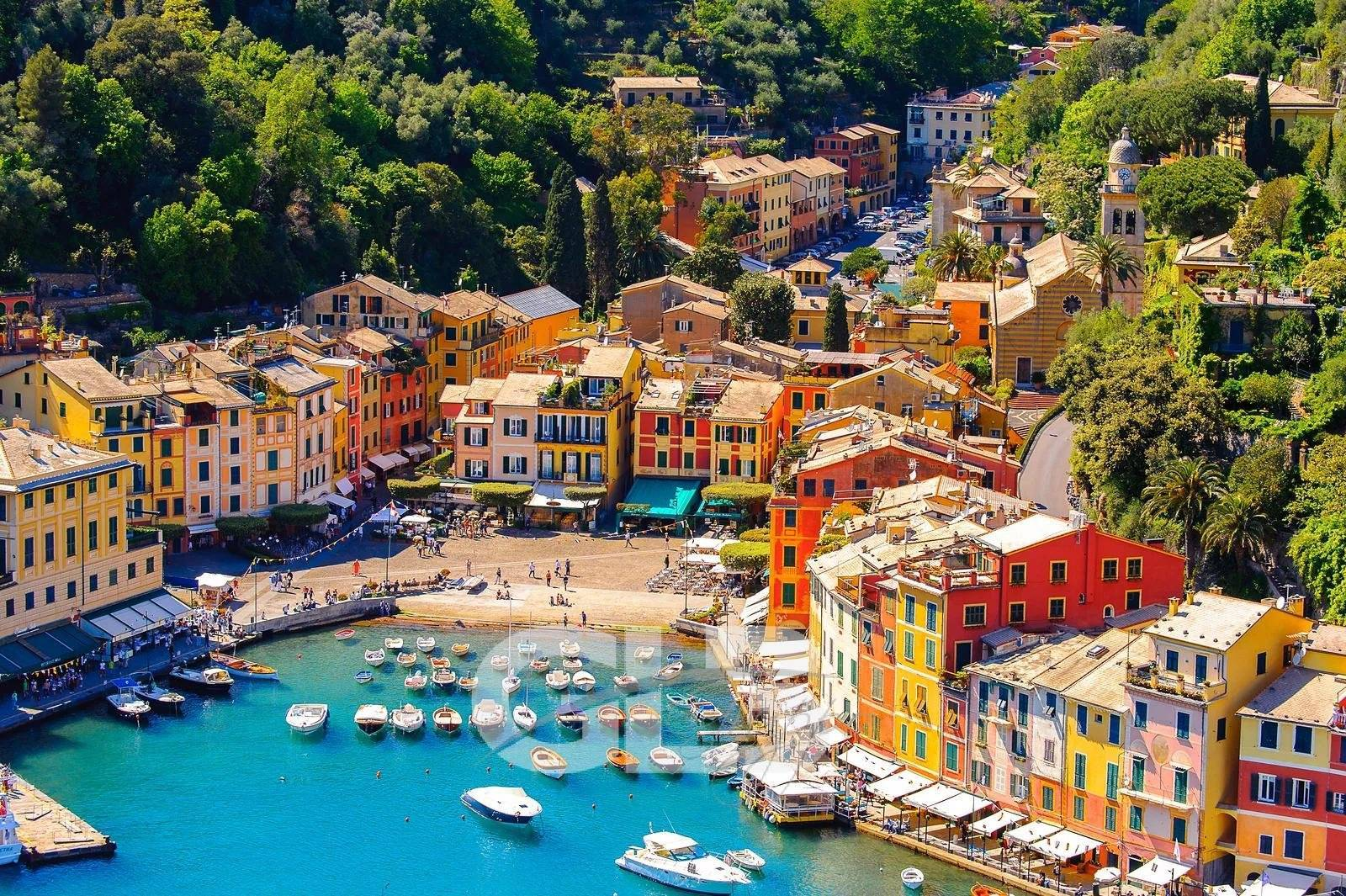PORTOFINO ITALY - MAY 4 2016: Aerial panorama of Portofino an Italian fishing village Genoa province Italy. A vacation resort with a picturesque harbour and with celebrity and artistic visitors.