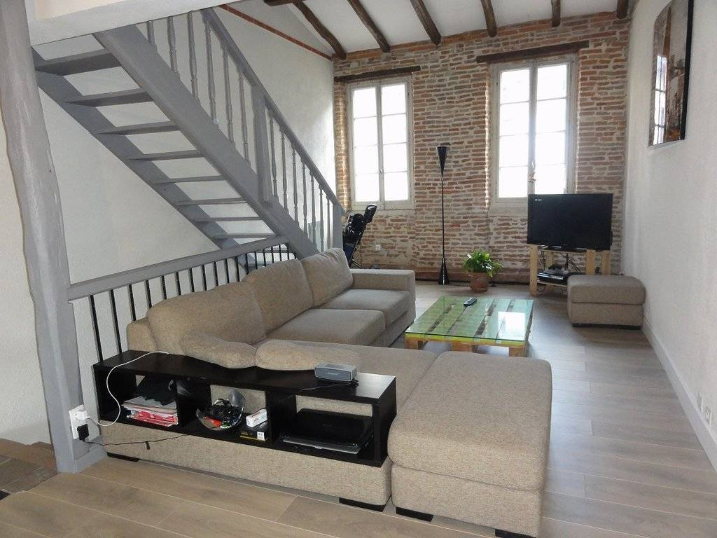 Living-room Wooden floor Exposed bricks
