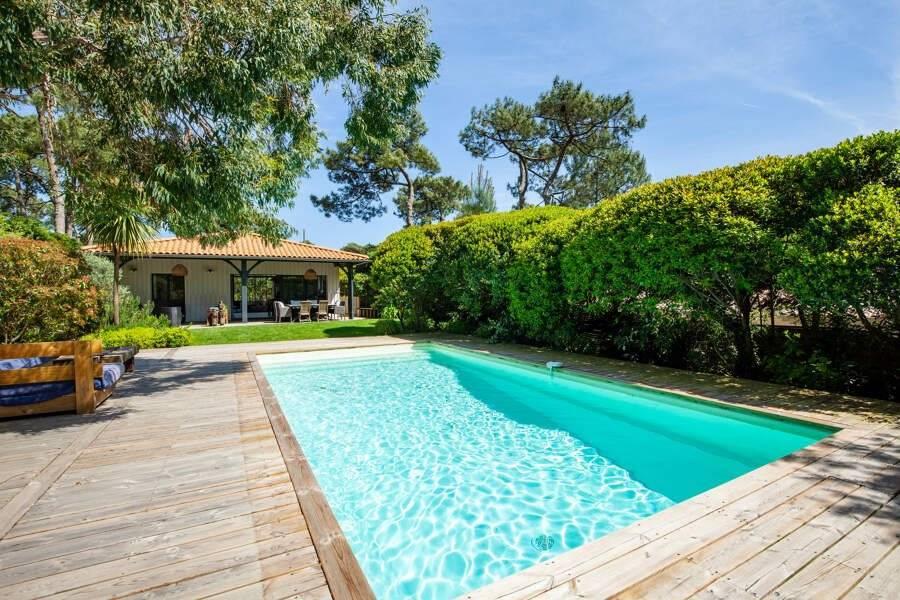 Cap Ferret - Location saisonnière - Maison - 12 Personnes - 5 Chambres - 3 Salles de bain - 220 m² - Piscine